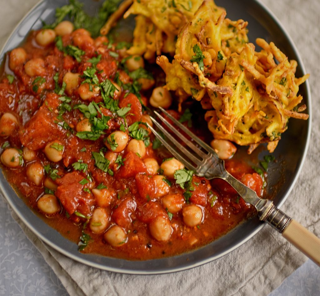 Vegan potato and mint pakora with spicy chickpeas