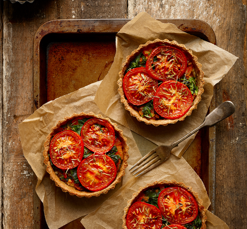 Herbed Cashew Cheese Tart with a tomato and onion topping