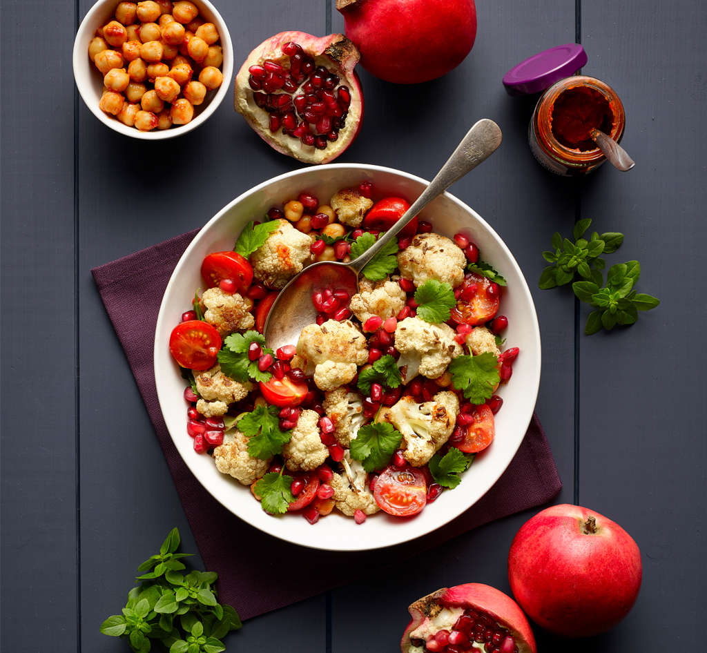 Warm Spiced Cauliflower and chickpea salad, with pomegranate seeds